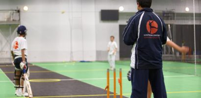 kids being coached cricket